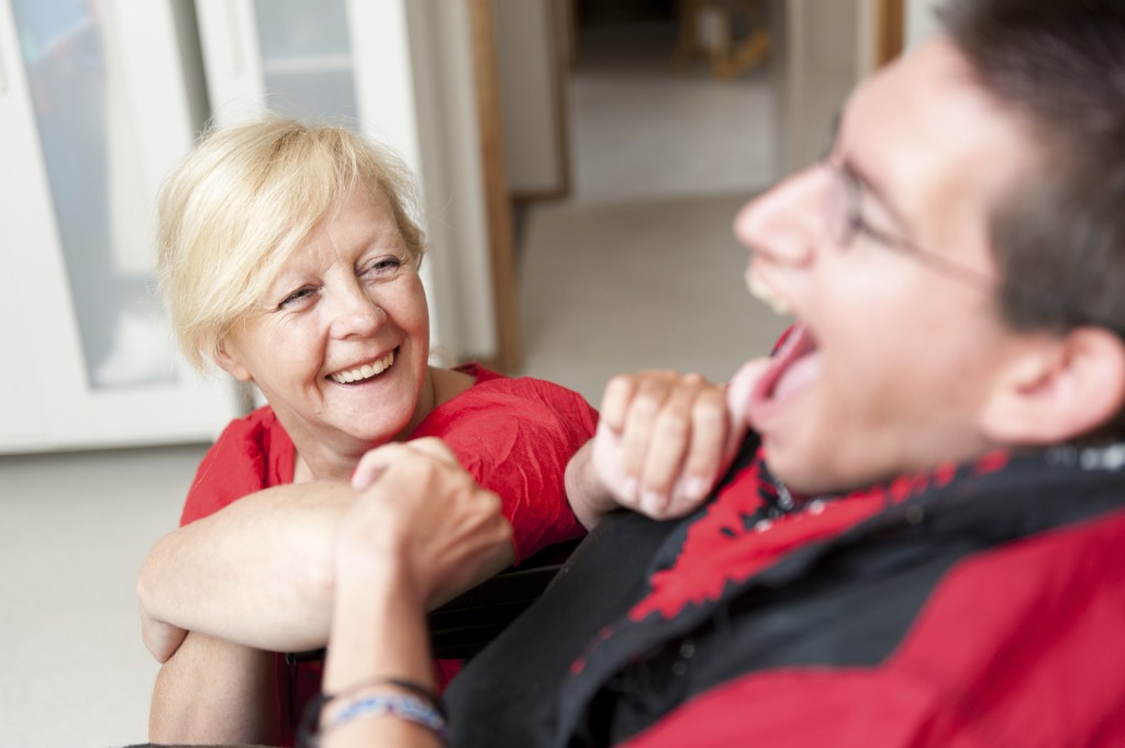 Disability Support Worker looking up at a Man